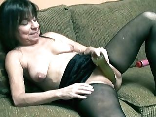 Nasty Black Haired Mummy With Saggy Globes Masturbates On Couch